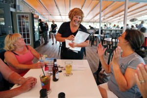 Ann LePage chats with diners after taking their order at McSeagull's restaurant on Thursday in Boothbay Harbor. The governor's wife has taken on a summer waitressing job.