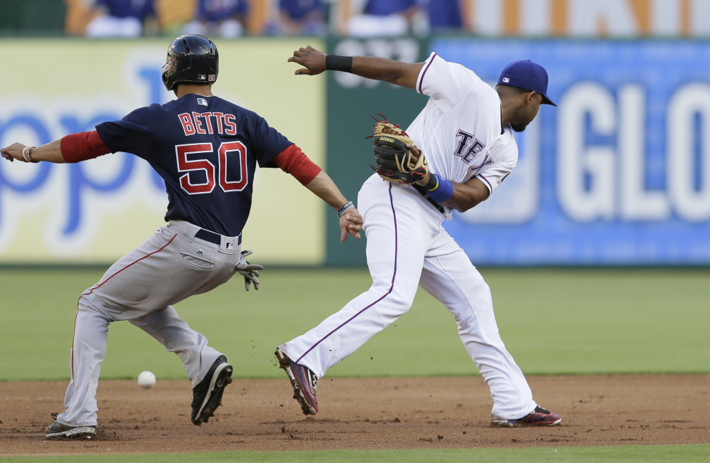 Boston's Mookie Betts steals second base as Rangers shortstop Elvis Andrus misses the throwing during the Red Sox' 8-7 win Friday in Arlington, Texas.