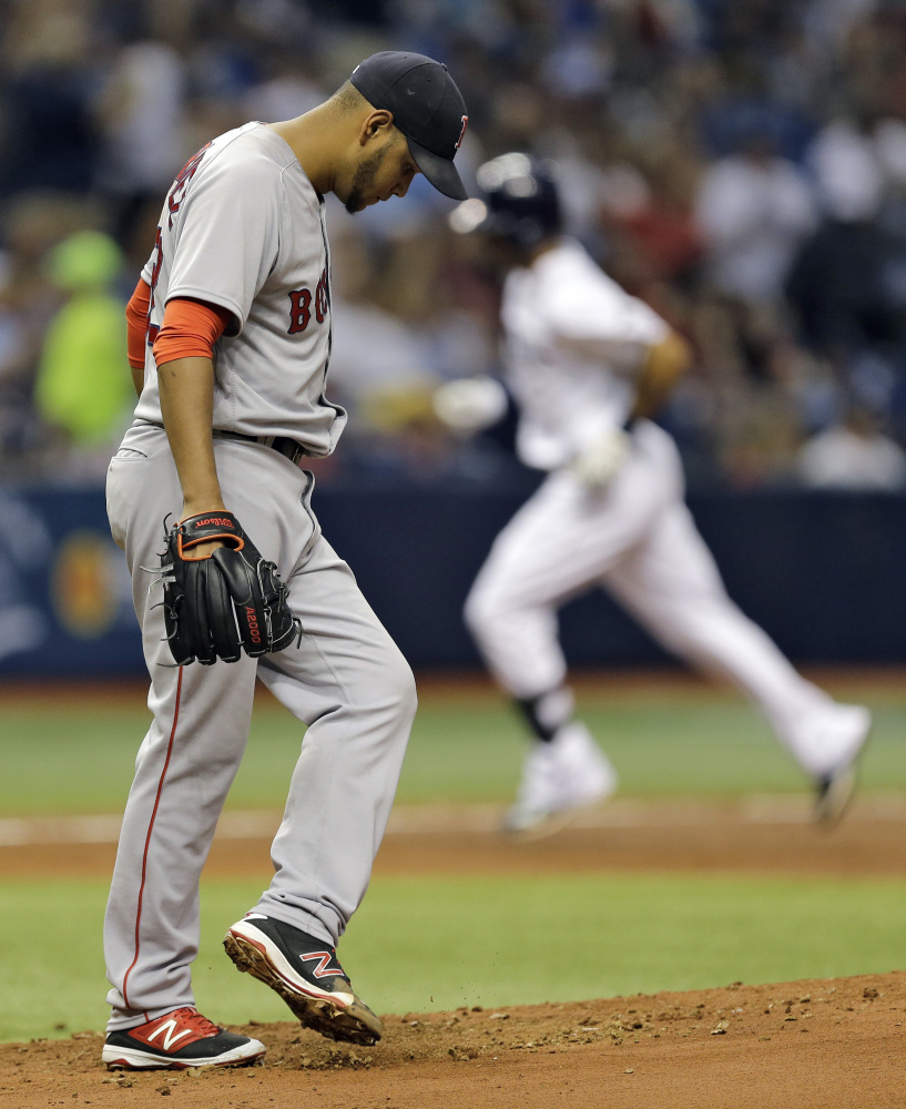 Eduardo Rodriguez kicks the mound as the Rays' Desmond Jennings runs around the bases after his home run in the third inning gave Tampa Bay a 9-0 lead.