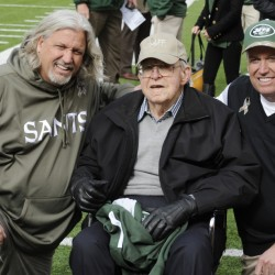 Then-New Orleans Saints defensive coordinator Rob Ryan, left, poses for a 2013 photographs with his father Buddy Ryan, center, and brother, then-New York Jets head coach Rex Ryan, right, before an NFL football game in East Rutherford, N.J. Buddy Ryan, who coached two defenses that won Super Bowl titles and whose twin sons Rex and Rob have been successful NFL coaches, died Tuesday. He was 82.