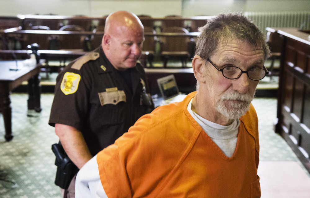 """Frank D. Fournier, convicted of murdering a man in Portland in 1987, leaves Lincoln County Superior Court after his resentencing hearing Tuesday. His attorney, Verne Paradie, said Fournier is """"very thankful that the court and the state did the right thing here."""""""