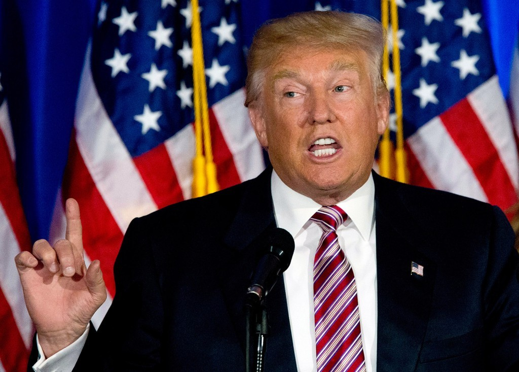 """Donald Trump, joined by his wife, Melania, speaks at a news conference Tuesday night at the Trump National Golf Club Westchester in New York. He said he understands """"the responsibility"""" of being the Republican presidential nominee."""