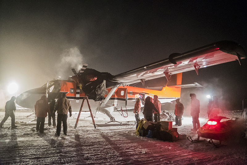 A small plane picks up sick workers at the U.S. South Pole science station.