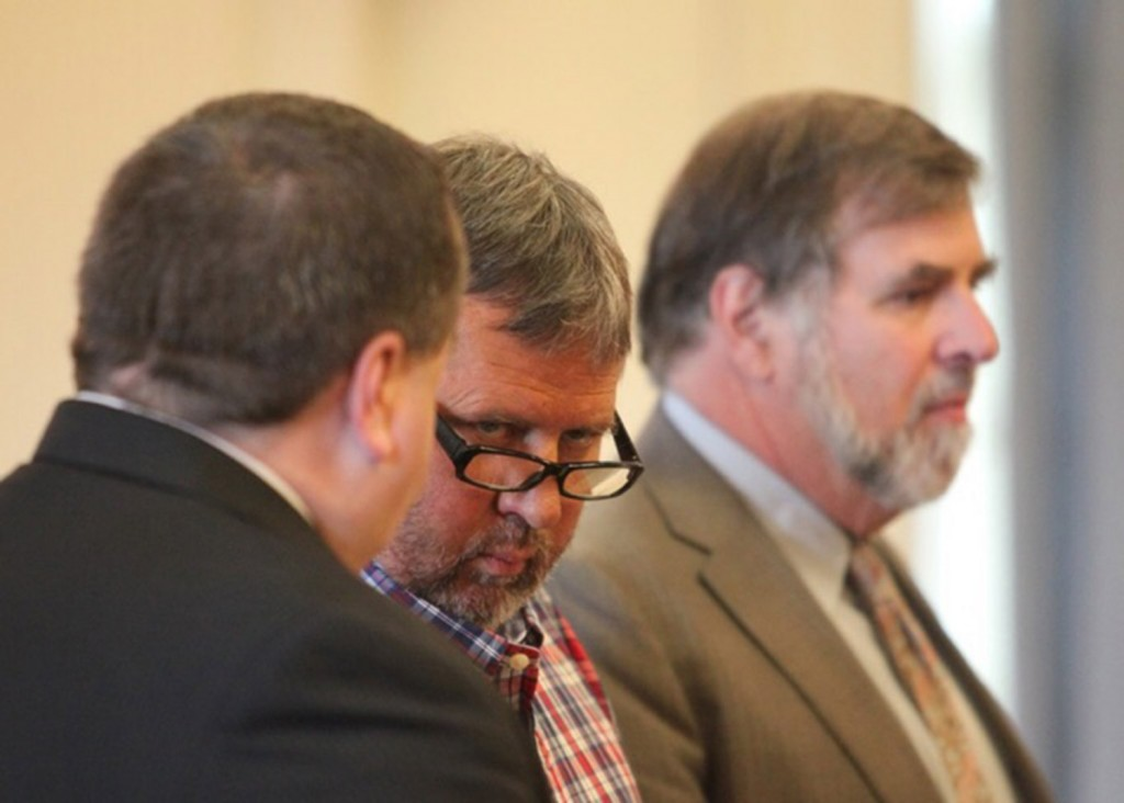 Bruce Akers, 57, of Limington, center, makes his initial appearance at York County Superior Court in Alfred center, on June 13, 2016, on a charge of murdering his Ossipee Trail neighbor, 55-year-old Douglas Flint. At left is attorney Robert LeBrasseur and at right is attorney Paul Aronson.