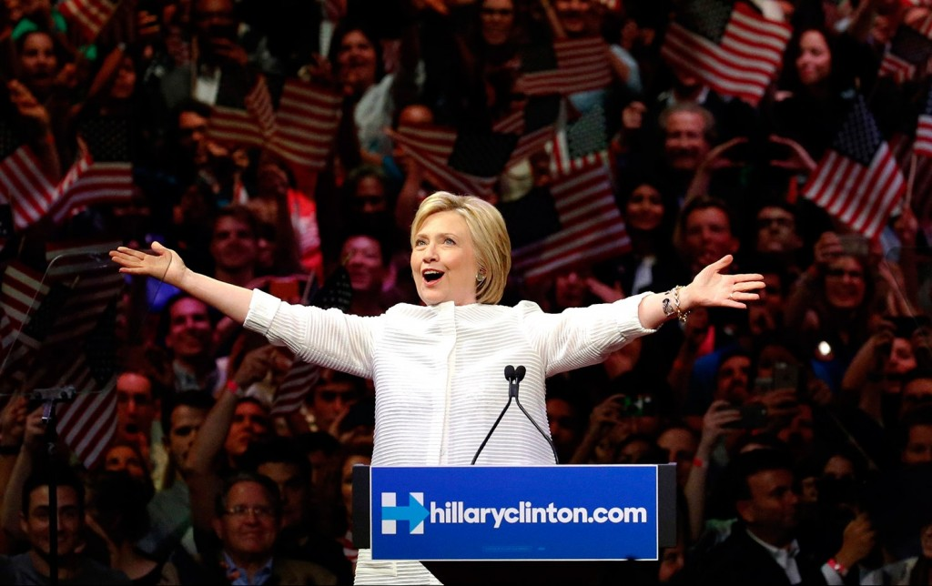 Hillary Clinton greets supporters at a rally in New York on Tuesday night as she claims the Democratic presidential nomination.  The Associated Press/Julio Cortez