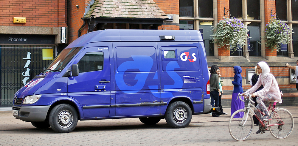 A G4S security van is parked outside a bank in Loughborough, central England, in August 2013. The company provides security for sports and rock stars in addition to 40 U.S. embassies and 32 juvenile-justice detention facilities in the U.S., including 28 residential centers in Florida. Reuters