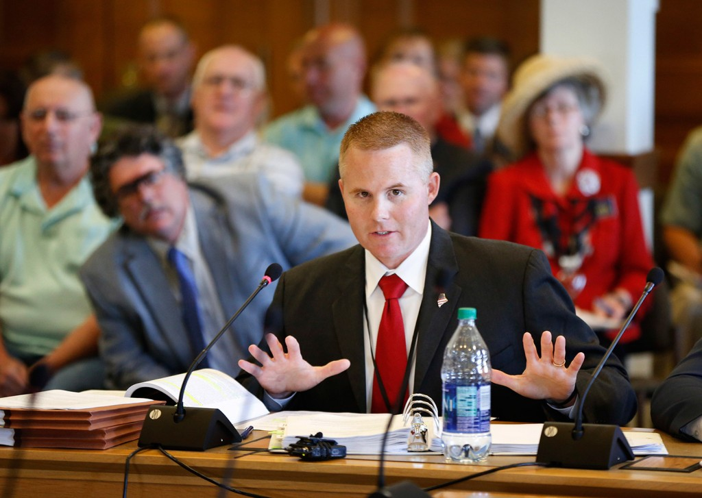 Col. Joel Wilkinson, chief of the Maine Warden Service, answers questions during a legislative meeting Wednesday about the conduct of Maine game wardens during undercover poaching investigations, at the State House in Augusta.