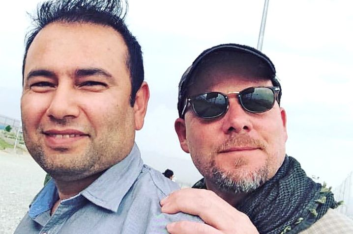 This undated photo provided by NPR shows Zabihullah Tamanna, left, and David Gilkey. Gilkey, a veteran news photographer and video editor for National Public Radio, and Tamanna, an Afghan translator, were killed while on assignment in southern Afghanistan on Sunday. Monika Evstatieva/NPR via AP