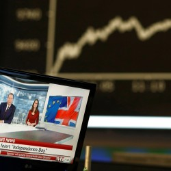 A news broadcast on a TV is pictured in front of the German share price index DAX board, at the stock exchange in Frankfurt, Germany after Britain voted to leave the European Union.    Reuters/Ralph Orlowski