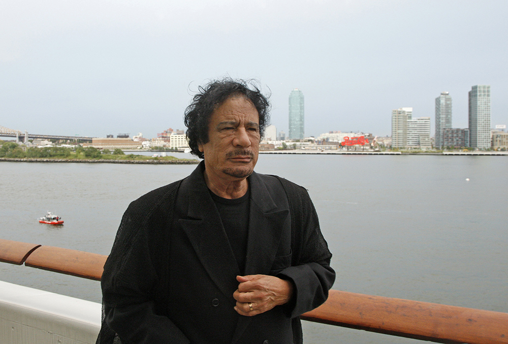 Libyan leader Moammar Gadhafi stands near a railing during a visit to New York in this Sept. 22, 2009, photo. Gaddafi was having a tent pitched on suburban New York property owned by Donald Trump until local officials stopped the work because it violated regulations. Gaddafi, known for pitching his large Bedouin tent on his trips abroad, was scheduled to address the U.N. General Assembly the next day. U.N. photo via Reuters