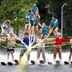 Members of Maine Attraction water show ski team carefully take their positions in a four-tier pyramid as they perform on Thursday. Derek Davis/Staff Photographer