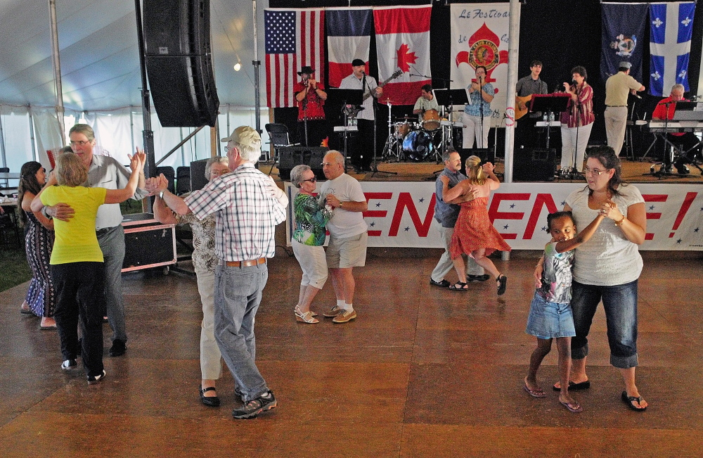 Dancers circle the floor as La Famille LeBlanc plays at the Festival de la Bastille on July 11, 2014 in Augusta. This year's festival is set for July 8 and 9.