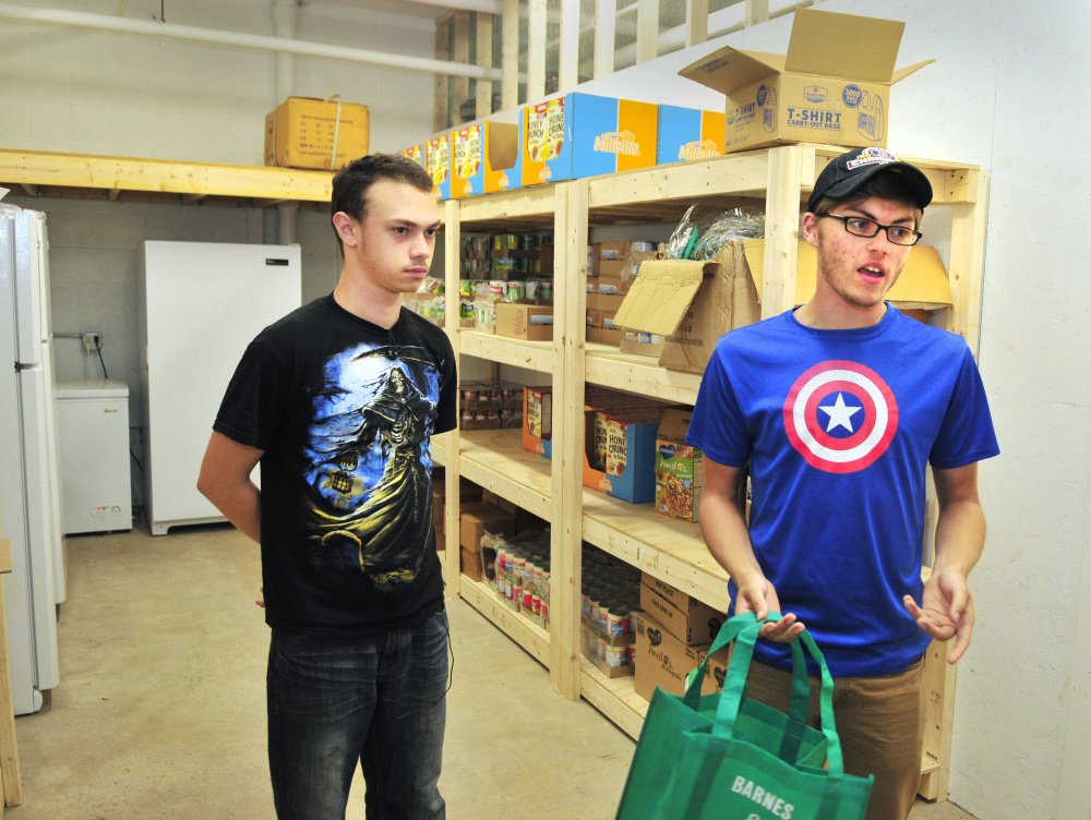 Kaleb Brann, left, and Jacob McKechnie talk about the new food bank program Thursday at the Augusta Boys and Girls Club in the Buker Community Center in Augusta.
