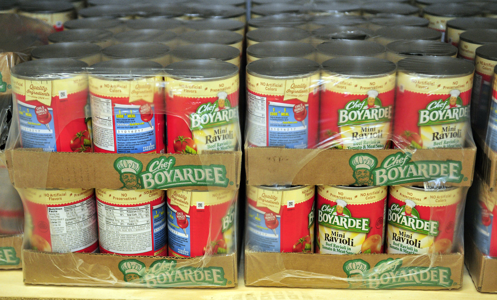 Canned pasta and other items sit on the shelves of the new food bank Thursday at the Augusta Boys and Girls Club in the Buker Community Center in Augusta.
