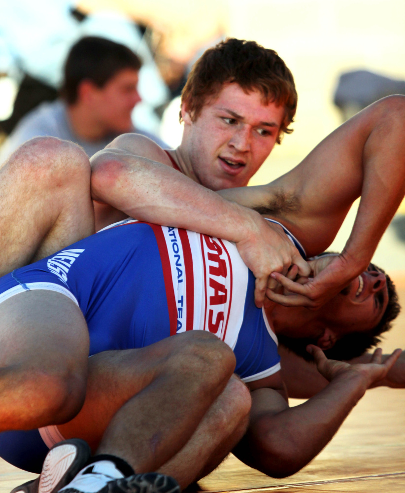 Winslow High School's Ryan Fredette, top, battles Nebraska's Patrick Ondrak during the 35th annual Maine-Nebraska wrestling exchange held Saturday in the Hight Chevrolet parking lot in downtown Skowhegan.