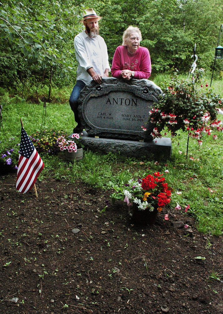 Scott Anton and his mother, Mary Ann, speak about her husband, Carl, who died last month and is buried on their property in West Athens.
