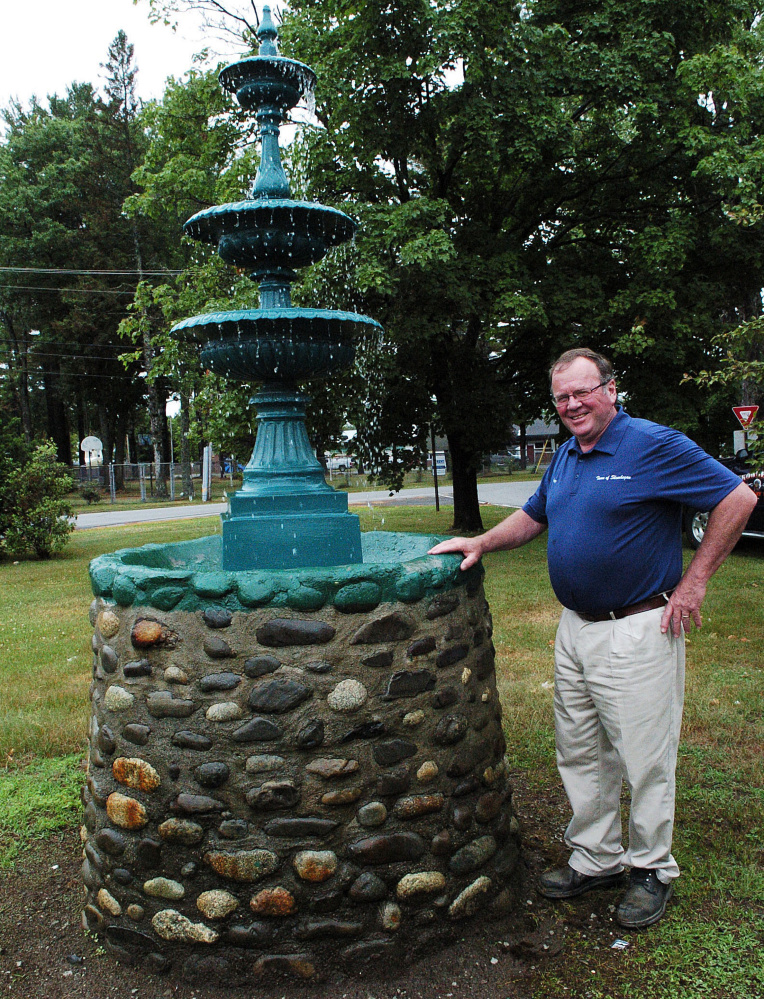 Greg Dore, the Skowhegan roads commissioner stands beside a new water fountain at the park off North Avenue and Jewett Street. The fountain was installed after the original one was vandalized three years ago.