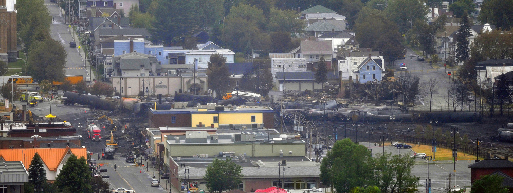Crude oil tankers from the Montreal, Maine & Atlantic railways are seen July 9, 2013, in the heart of downtown Lac-Megantic, Quebec, where the runaway train exploded, killing 47 on July 6 of that year.