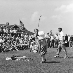 Contributed photo/Waterville Country Club Gene Sarazen swings a club as two-time Masters champion Horton Smith, right, looks on during an exhibition match at the Waterville Country Club sometime in the 1930s. The club is celebrating its centennial this season.