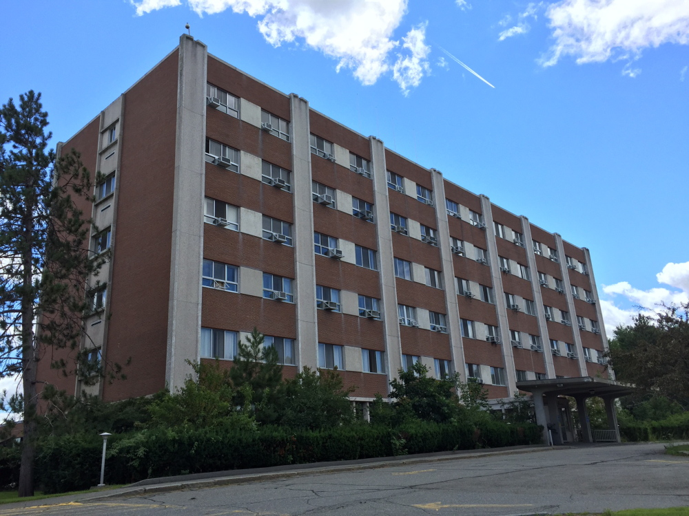 An $11 million project is planned to turn the former Seton Hospital on Chase Avenue into a complex with 50 one- and two-bedroom apartments. City councilors have agreed to rezone the property.