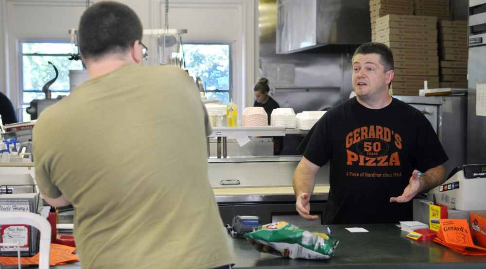 Gerard's Pizza proprietor Jeff McCormick speaks with customer Ben Tracy, of Gardiner, August 10, 2015, at the counter of the Gardiner restaurant. A fundraiser will be held Saturday to benefit McCormick, who is battling cancer.