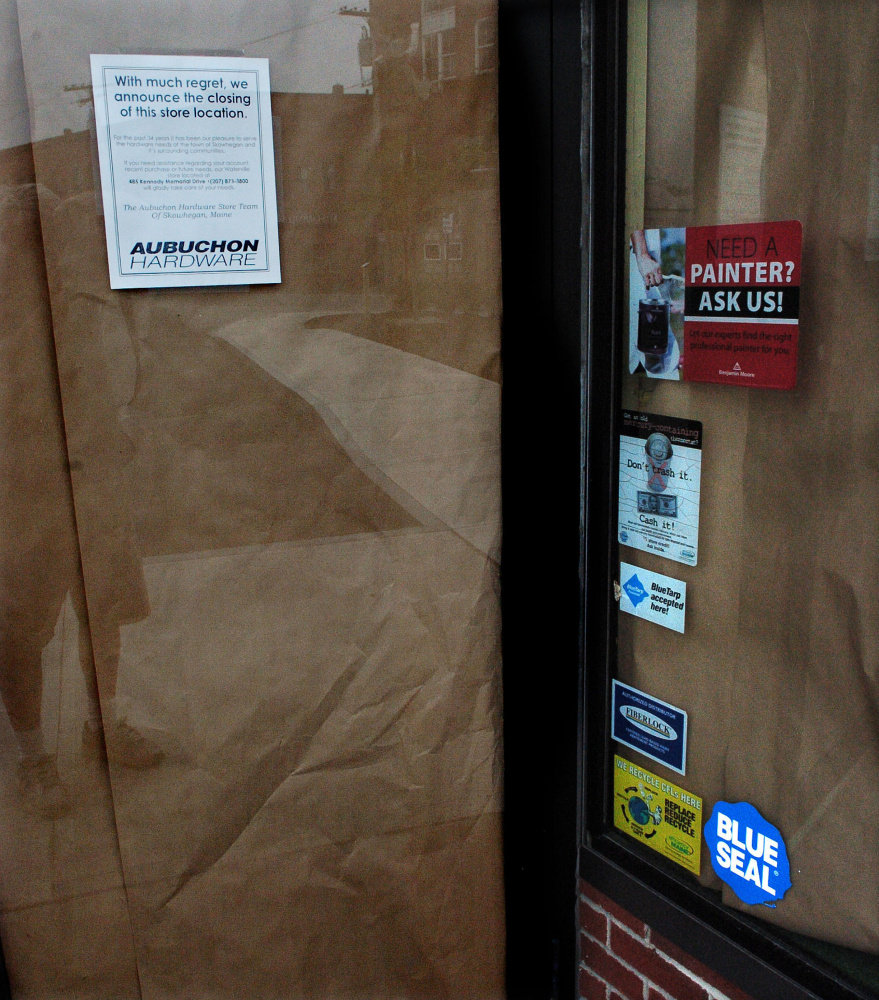 The entrance door to the Aubuchon Hardware store in Skowhegan was covered in brown paper Thursday with a sign announcing the business has closed.