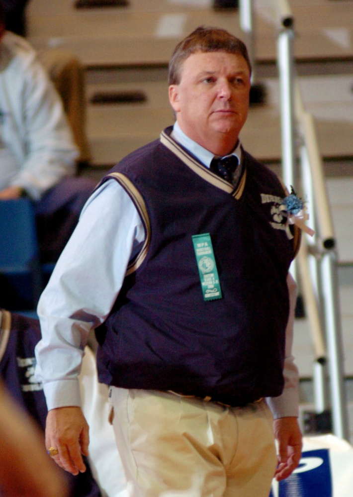 Former Dirigo boys basketball coach Gavin Kane watches the action during a 2006 tournament game at the Augusta Civic Center. Kane coached the Mt. Blue girls team the last two seasons, going 20-16. However, he resigned this week, citing a change in sports culture.