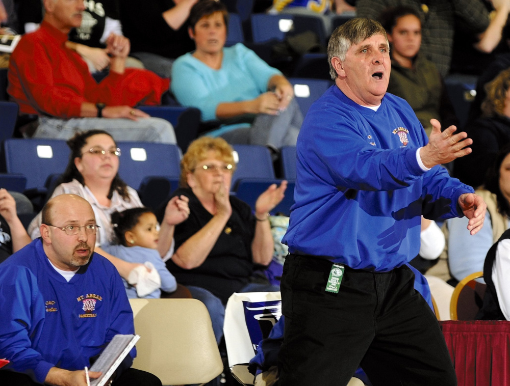 Mt. Abram girls basketball coach Doug Lisherness urges his team on during a 2008 Western C tournament game at the Augusta Civic Center.
