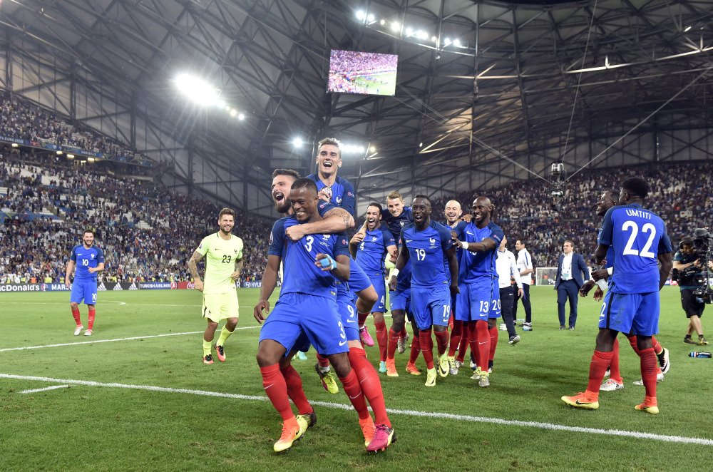 France players celebrate with the supporters at the end of the Euro 2016 semifinal against Germany at the Velodrome stadium in Marseille, France on Thursday.