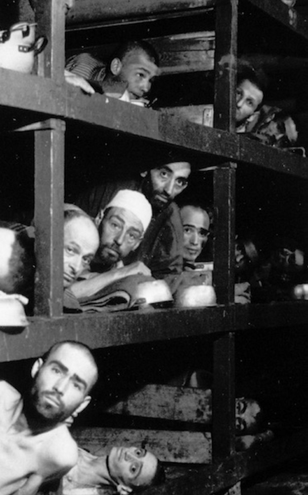 This April 16, 1945 file photo provided by the U.S. Army, shows inmates of the German KZ Buchenwald inside their barrack, a few days after U.S troops liberated this concentration camp near Weimar. The young man fourth from left in the middle row bunk is Elie Wiesel, who would later become an author and Nobel Peace Prize laureate.