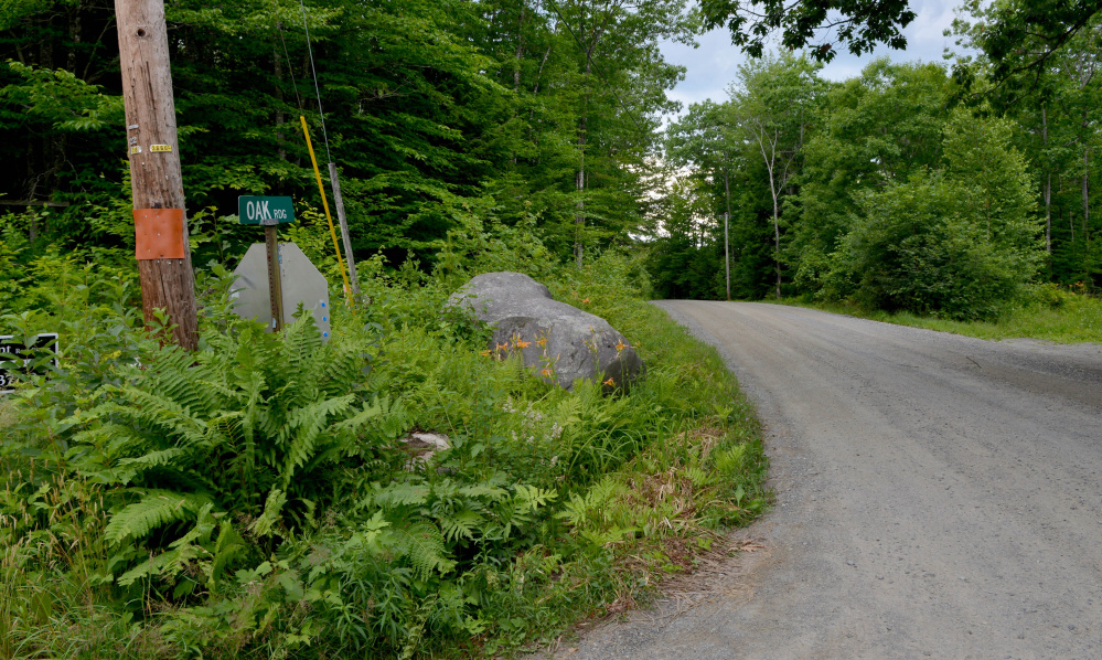 The entrance to Tuttle Cemetery in Rome is on Oak Ridge, seen here Tuesday, a road that is owned by Peter Fotter. The town of Rome alleges Fotter is blocking access to the cemetery even though the town has a right of way and Fotter has a responsibility to maintain the entrance.