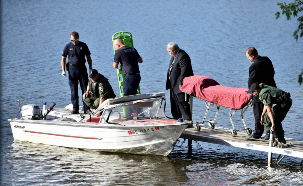Funeral home workers from Smart and Edwards in Skowhegan arrive June 30 at the Oosoola Park boat landing on the Kennebec River in Norridgewock to transport a drowning victim, Barbara York, of Waterville.