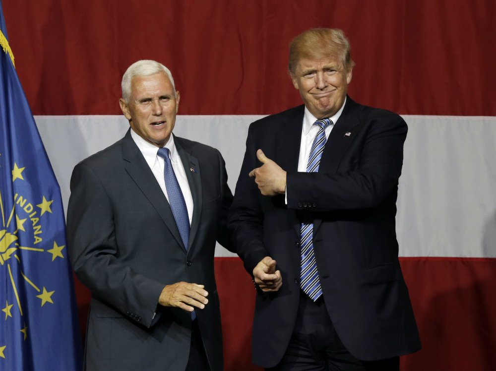 Indiana Gov. Mike Pence joins Republican presidential candidate Donald Trump at a rally in Westfield, Ind., July 12. Pence's decision to join Trump on the ticket is at odds with his previous positions.