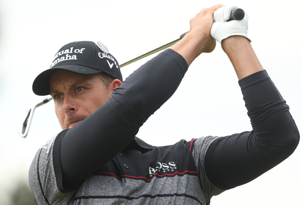 Henrik Stenson hits his tee shot from the 12th hole. Stenson set a record for lowest 72-hole score in a major championship, finishing at 20-under 264.
