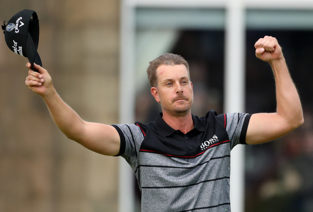 Henrik Stenson celebrates his win Sunday at the British Open after putting out on the 18th green at Royal Troon Golf Club, in Troon, Scotland.