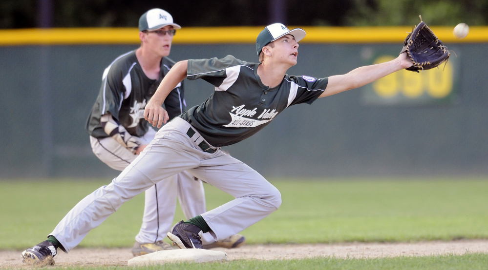 Apple Valley's Greg Fay can't grab an errant throw to second during the 13-15 Babe Ruth state championship game Monday night in Augusta.