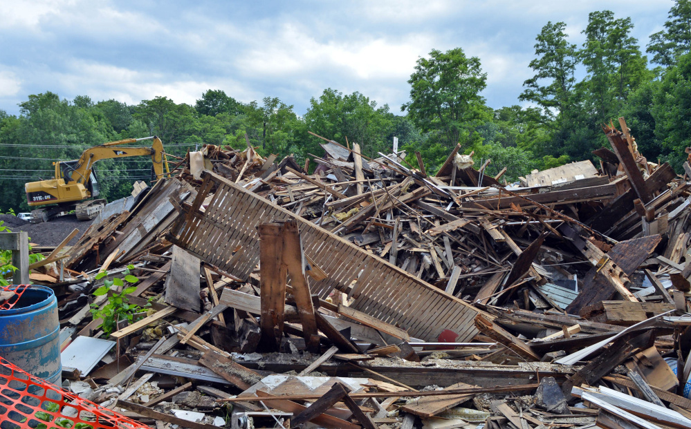 The rubble of a building is all that remains at 2 Lithgow St. in Winslow. The owner said he has no current plans for the former Fortin's Home Furnishings warehouse site.