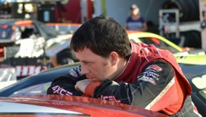 Travis Benjamin, of Morrill, takes a break between between practice sessions at a recent Pro All Stars Series race at Beech Ridge Motor Speedway.