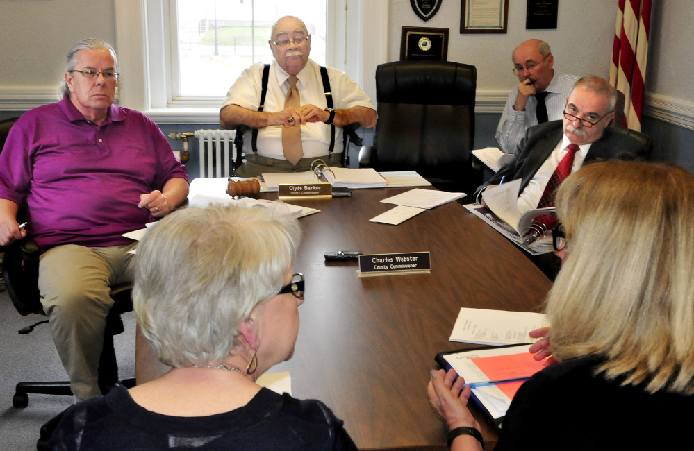 Franklin County Commissioners, from left, Gary McGrane, Clyde Barker and Charles Webster, far right, listen to representatives of Seniors Plus, foreground, during a budget meeting in April in Farmington. The commissioners voted to set the county tax rate Monday, making it the same as last year.