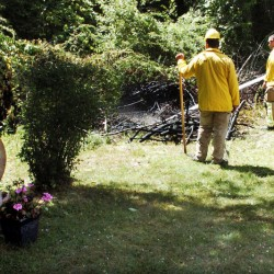 Waterville firefighters extinguish a suspicious fire Thursday in some brush beside grave sites at the St. Francis Catholic Cemetery in Waterville.