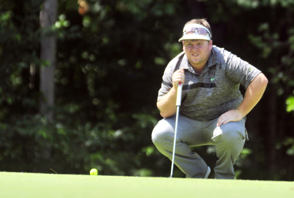 Ryan Gay lines up a putt during the Charlie's Open last summer at the Augusta Country Club. (Staff file photo)