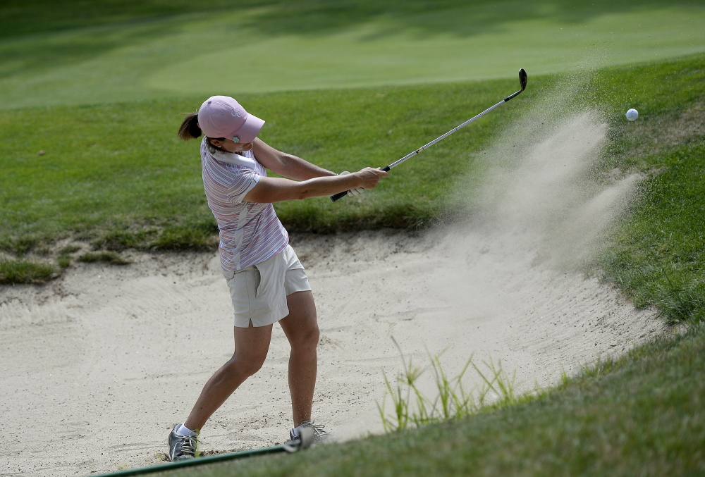 Staci Creech plays a shot out of a bunker during last year's Maine Women's Am. (Staff file photo)