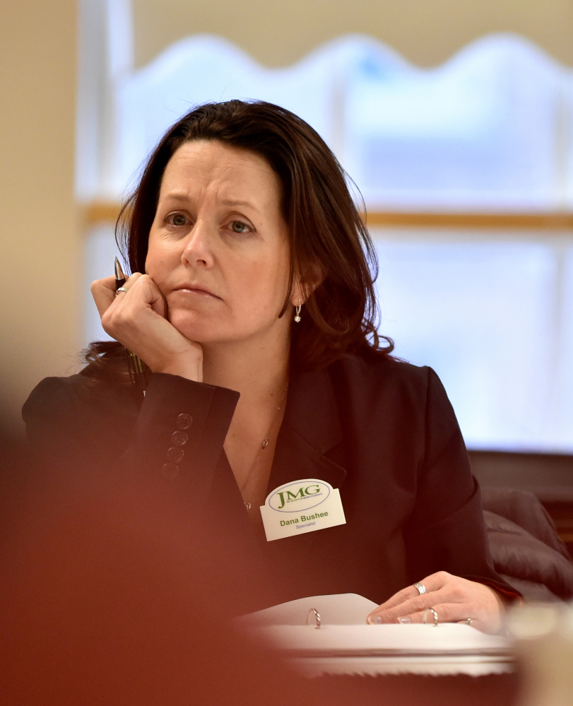 Ward 6 Councilor Dana Bushee listens during city budget talks in March. Bushee voted Tuesday to override Mayor Nick Isgro's veto of the $38 million city budget, but said she will reconsider that vote at the council's Aug. 1 meeting.