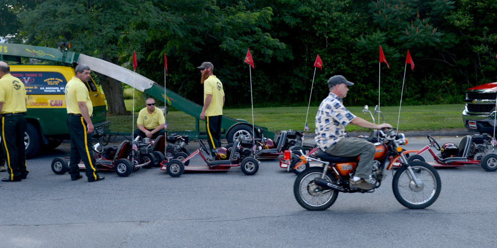 Kora Shriners wait by their go-carts for the start of the OakFest parade in Oakland on Friday.