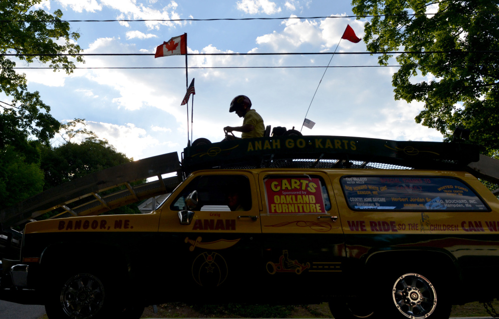 Kora Shriners go-cart drivers perform during the OakFest parade in Oakland on Friday.