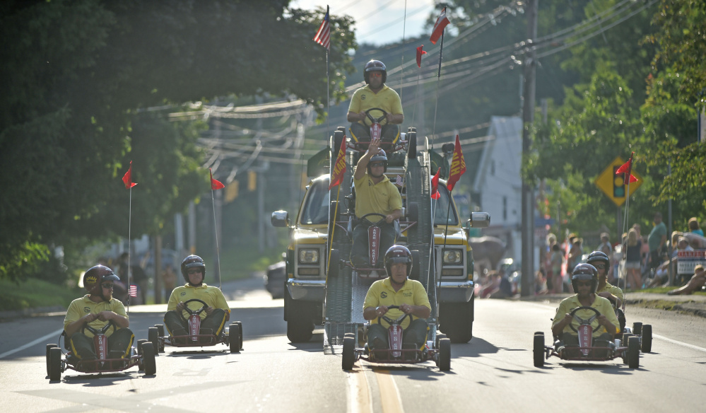 The Kora Shriners go-cart stunt team performs for paradegoers during the OakFest parade in Oakland on Friday.