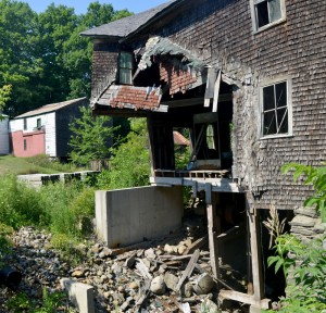 The Branch Pond Dam and mill in South China, seen Friday, will be repaired now that owners, the town and state agencies have reached a settlement regarding the historic mill and dam.