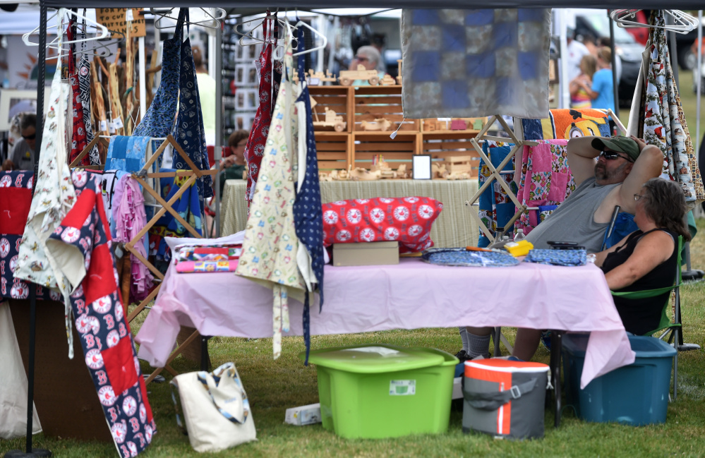 Vendors display their crafts during OakFest in Oakland on Saturday.