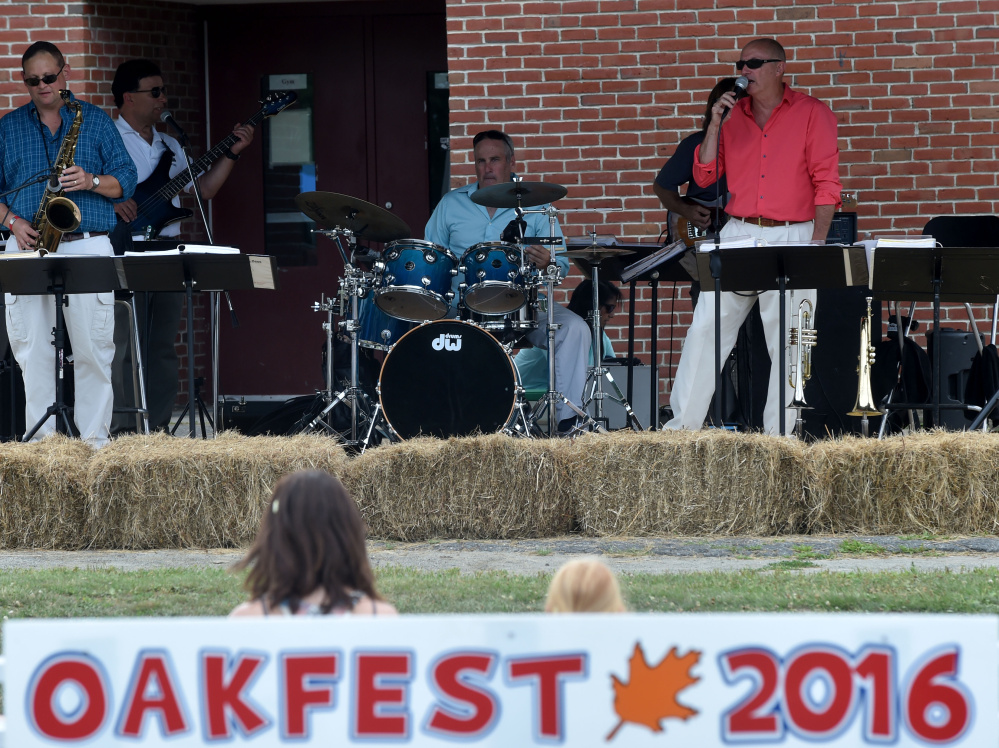 The Scott Davis Band performs during OakFest in Oakland on Saturday.