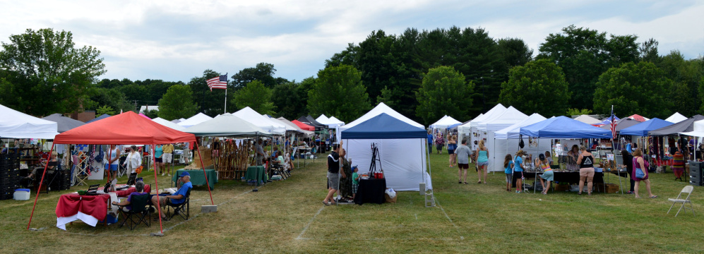 Artisan crafts vendors pack the lawn next to Williams Elementary school during OakFest in Oakland on Saturday.